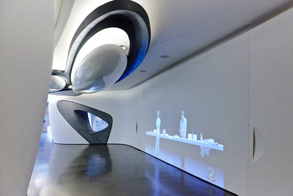 zaha hadid white curved interior and lighting of roca gallery london by airey spaces