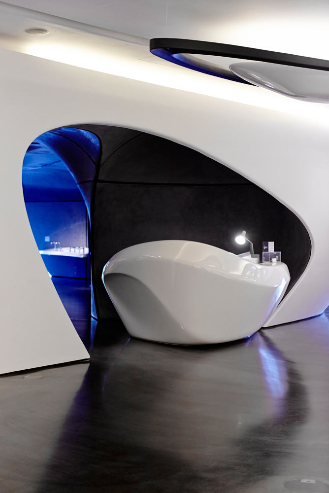 zaha hadid white curved interior reception desk of roca gallery london by airey spaces