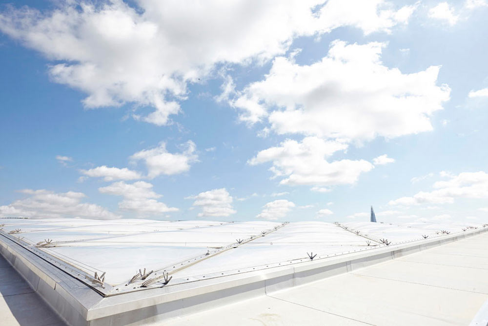 rooftop and blue sky with clouds on St Thomas' hospital by Airey Spaces