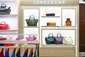 Shelving detail and bag in Harrods store for Longchamp by Airey Spaces