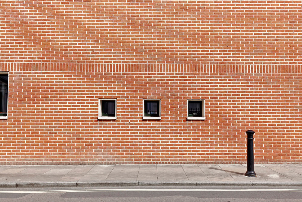 red brick work and small windows of Pallant House Gallery by Airey Spaces