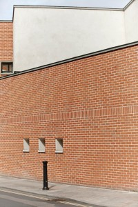 modern red brick extension building to Pallant House Gallery by Airey Spaces