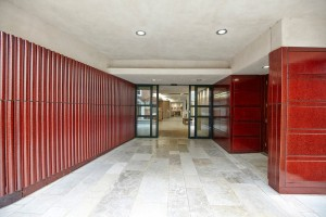 modern red entrance to Pallant House Gallery by Airey Spaces