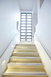 modern staircase and window in Art Gallery by Airey Spaces