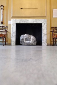 traditional art gallery interior with stone artwork by Airey Spaces
