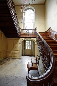traditional wooden ornate staircase in art gallery by Airey Spaces