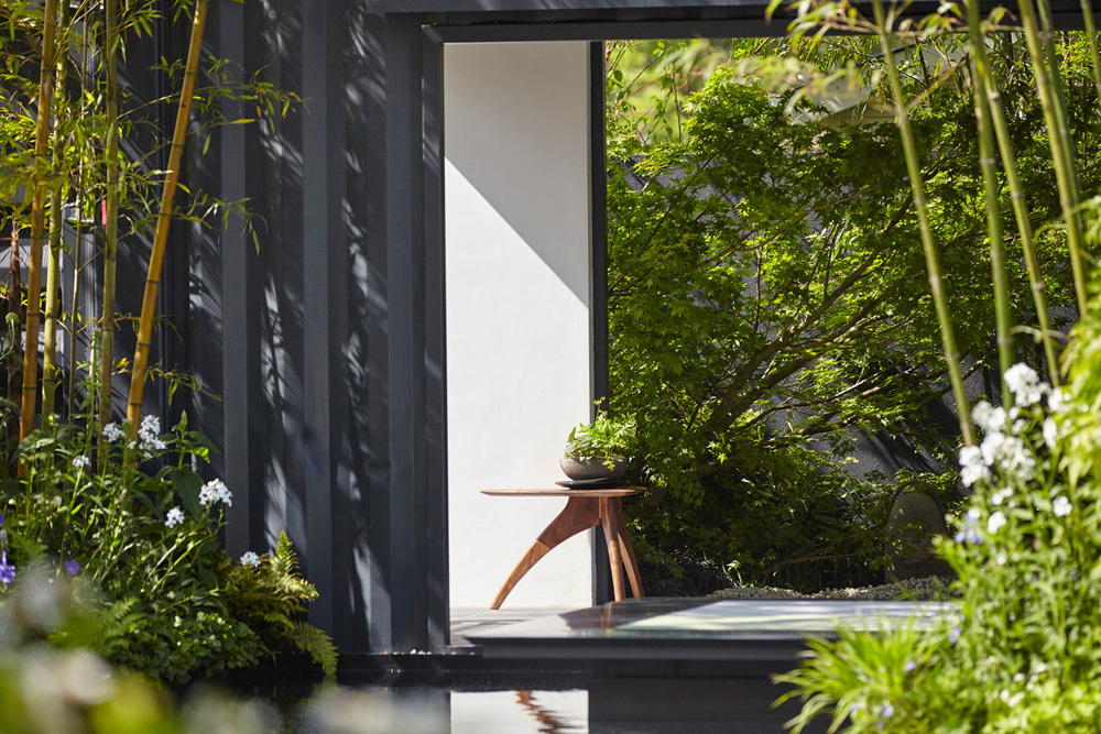 garden design with black wall and bamboo by airey spaces