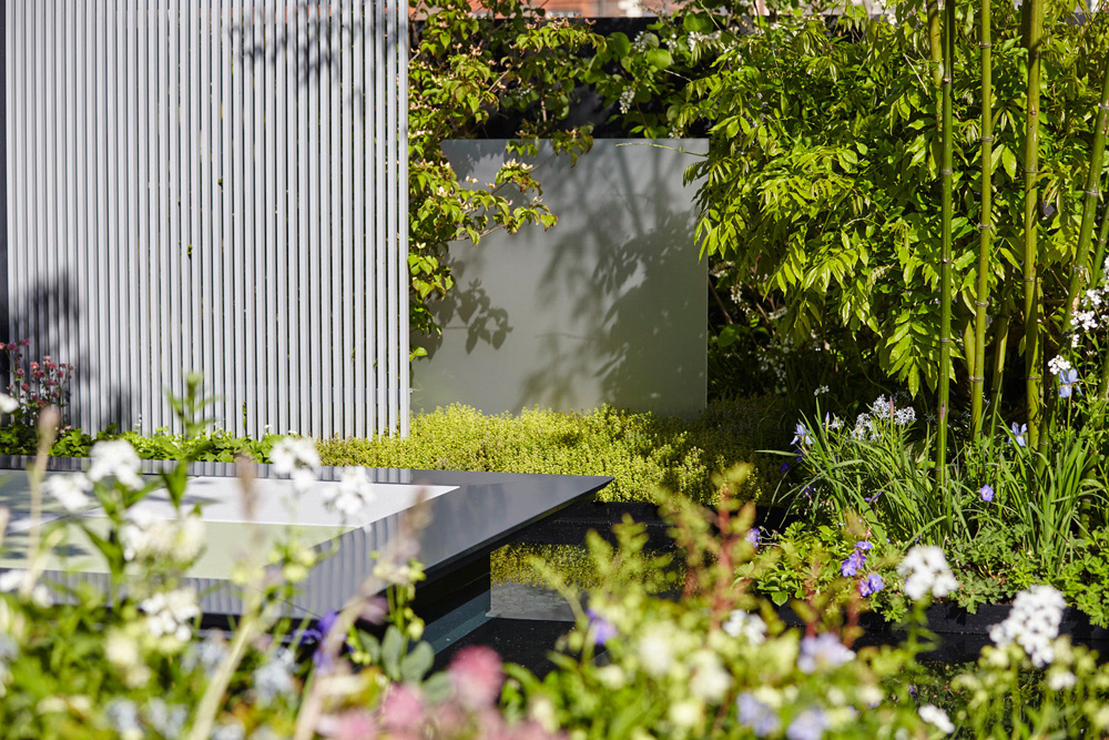 modern garden design with metal walls by airey spaces