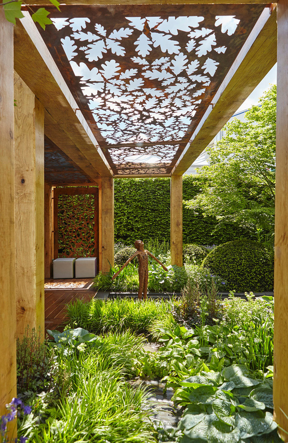 wooden garden structure with metal roof and leaf cut out by airey spaces