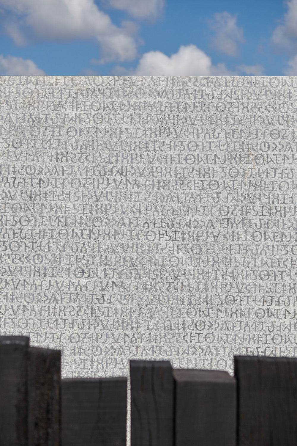 text scribed on white granite and marble by airey spaces