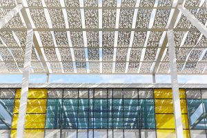 white ornate metal roof work of office building by Airey Spaces