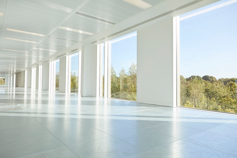 large blue sky windows in modern offices by Airey Spaces