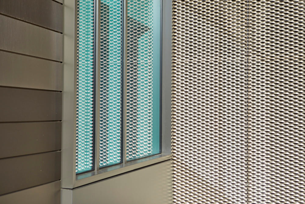 metal cladding and window of new modern office building by Airey Spaces