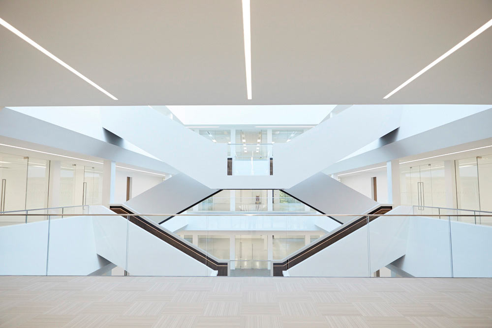 large atrium staircase in new modern office by Airey Spaces