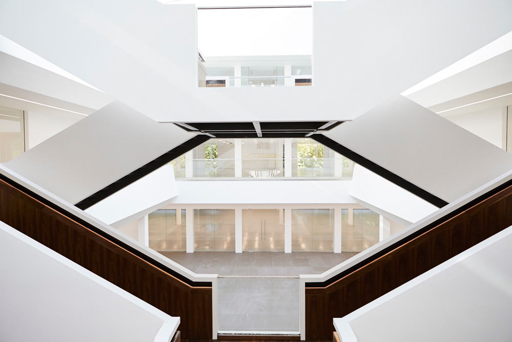 white light staircase in atrium of new office development by Airey Spaces
