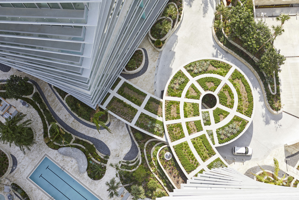 aerial shot looking down of grass rooftop joining apartment buildings in Miami by Airey Spaces