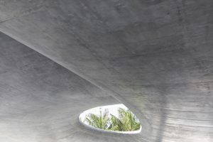 concrete canopy and palm trees at modern apartment building in Miami by Airey Spaces