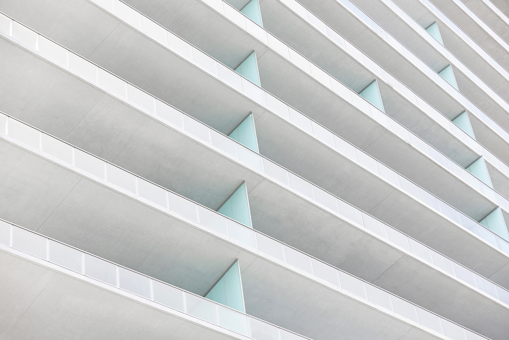graphic detail shot with concrete and turquoise of apartment balconies in Miami by Airey Spaces