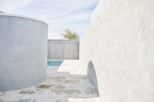 concrete walls surrounding small rooftop plunge pool by Airey Spaces