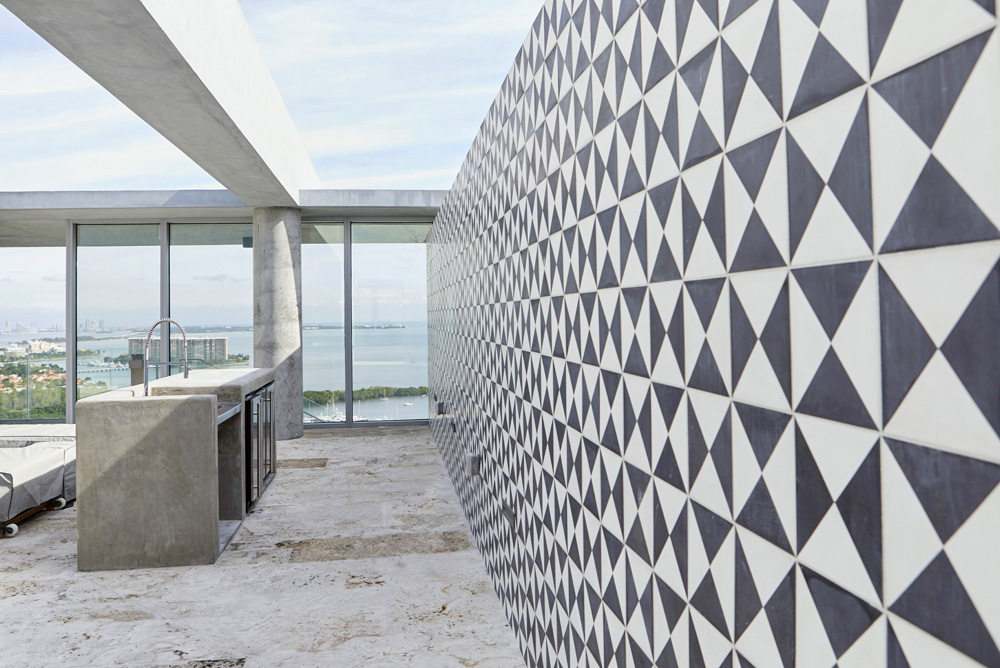 roof top pool with black and white tiling and sea view in Miami by Airey Spaces