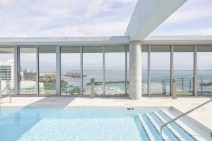 rooftop swimming pool with ocean view in Miami by Airey Spaces