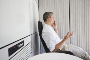 man on phone in sound booth in modern office