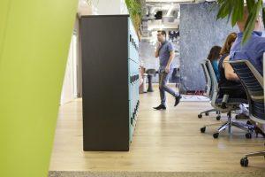 man walking through modern open plan office environment