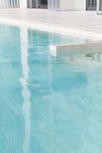 swimming pool and marble at Muraba Residences on Palm Jumeirah by Airey Spaces