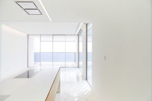 large glass window in modern apartment at Muraba Residences, Palm Jumeriah by Airey Spaces