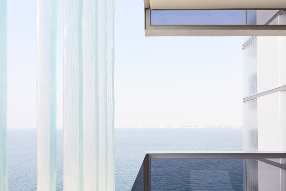 glass panels on balcony with sea view in modern apartments Muraba Residences on Palm Jumeirah by Airey Spaces