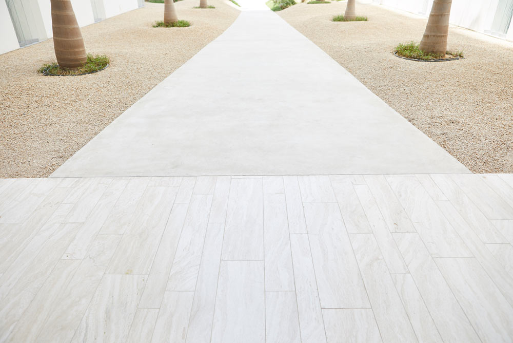 marble entrance walkway in modern Muraba Residences, Palm Jumeirah by Airey Spaces