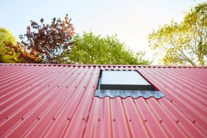 red tin roof and skylight window on scottish house by Airey Spaces