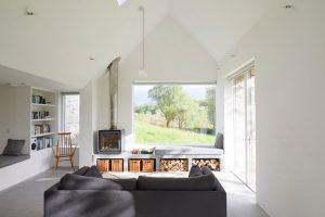Scottish modern house interior with window seat and wood burner by Airey Spaces