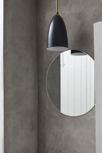 bathroom detail light fitting with grey concrete walls by Airey Spaces