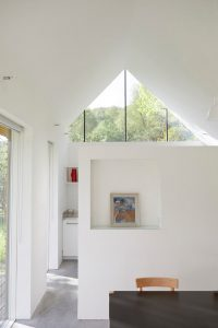 Scottish modern house interior with triangular window by Airey Spaces