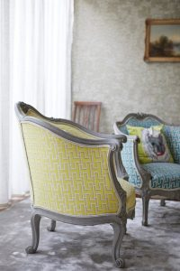 yellow and grey stylish chair in Velvet Orange Interiors house by Airey Spaces