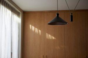 stylish ceiling light in wooden office by Velvet Orange Interiors