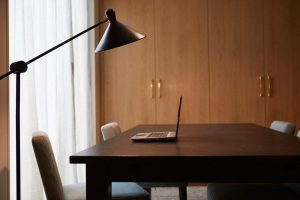 stylish standing lamp and table in office by velvet orange interiors
