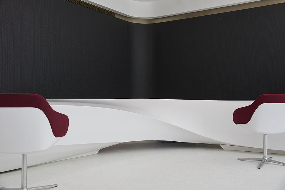 modern white desk and chairs in office reception by Airey Spaces