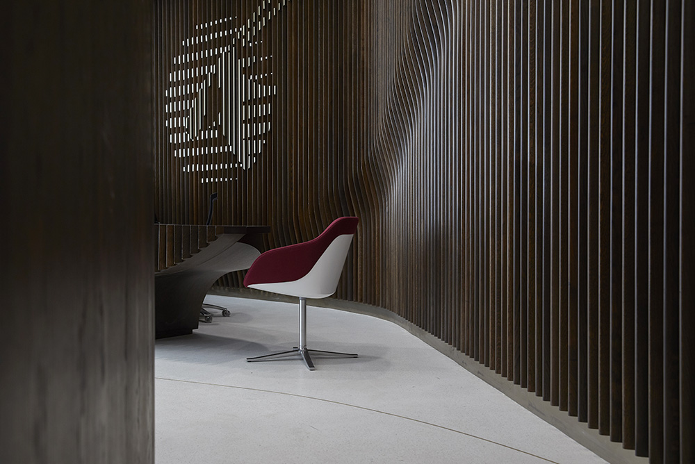 rich dark wood cladding in modern office reception by Airey spaces