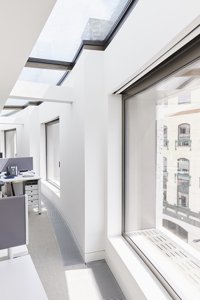 geometric sky roof lighting and large recessed office windows by Airey Spaces
