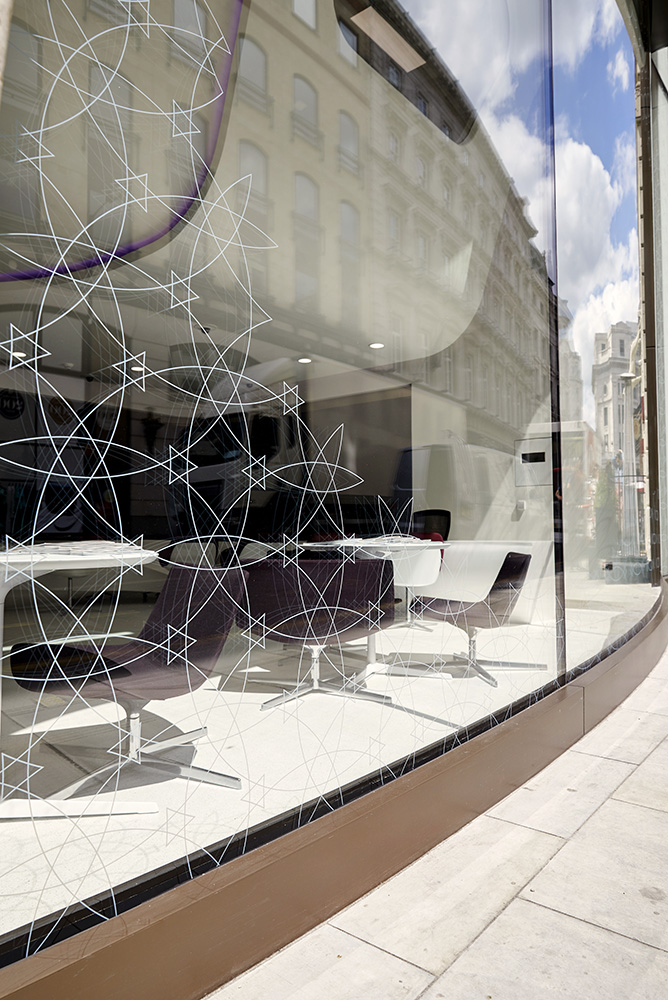 ornate glass and curved facade of modern office building London by Airey Spaces