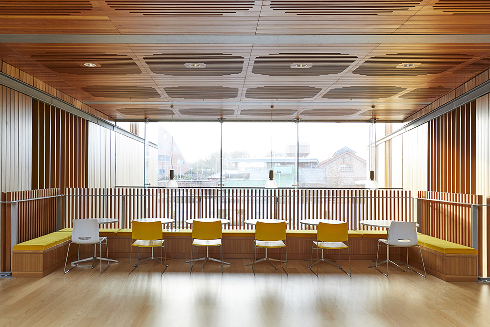 airy modern office interior with wooden features by Airey Spaces