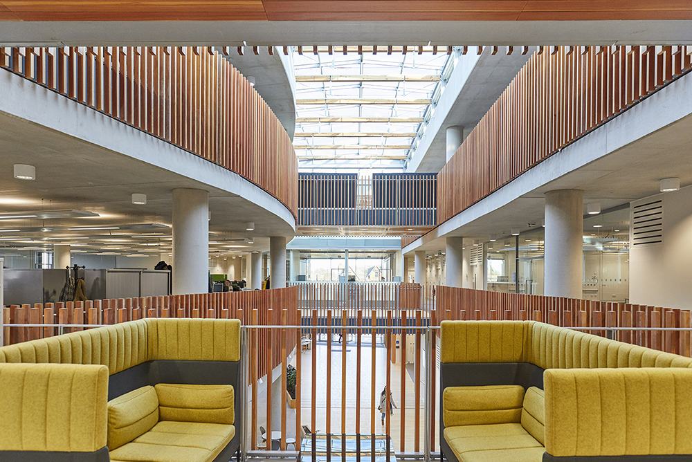 comfortable seating in modern office interior glass ceiling wooden features by Airey Spaces