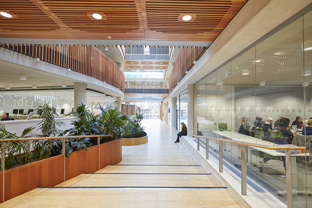 light open modern architecture atrium and wooden finishes by Hopkins Architects photography Airey Spaces
